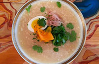 brown rice congee w/ boiled egg & pickled turmeric